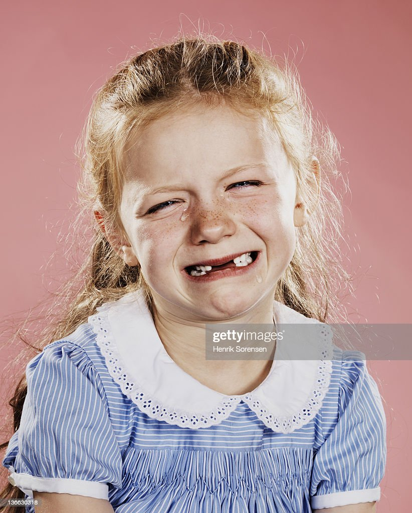 Portrait of young girl crying : Stock Photo