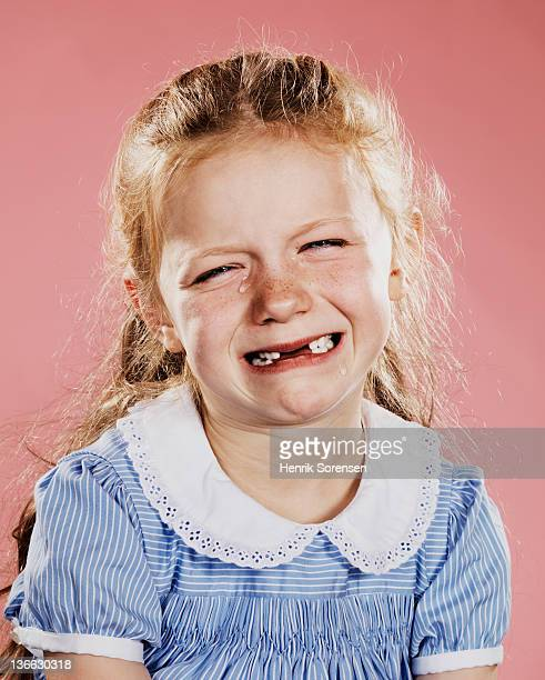 portrait of young girl crying - bad teeth stock photos and pictures