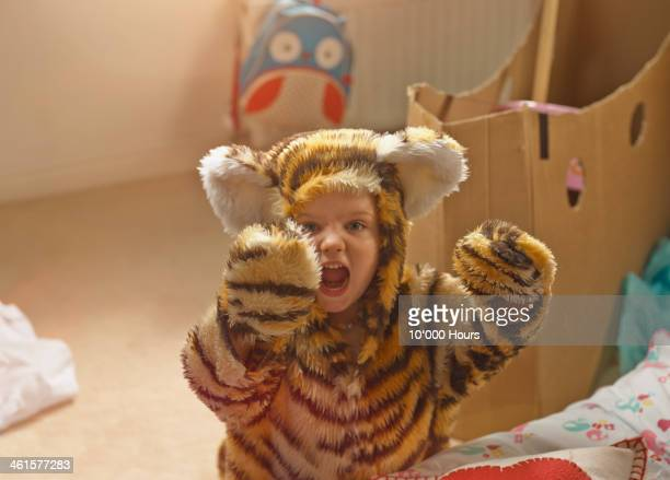 portrait of young girl dressed as a tiger - animal costume stock pictures, royalty-free photos & images