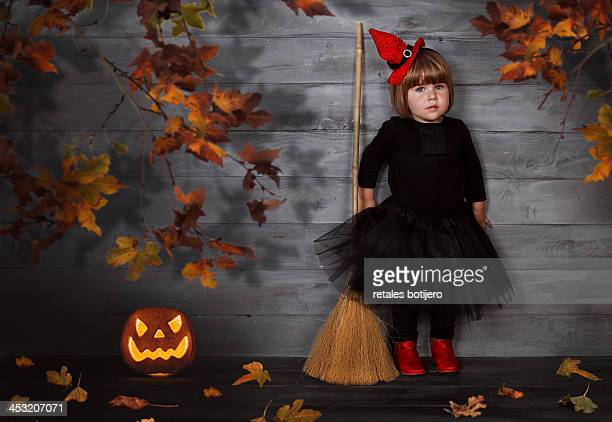 Portrait of young girl dressed as a witch