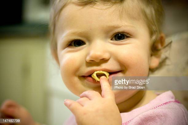Portrait of young girl eating noodle