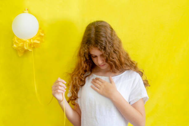 Portrait of young girl holding balloon