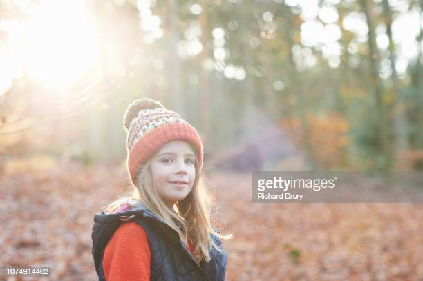 Portrait of young girl in Autumnal woodland