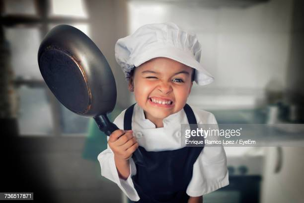 Portrait Of Young Girl In Chefs Outfit