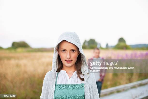 """portrait of young girl in foreground of field - """"compassionate eye"""" fotografías e imágenes de stock"""