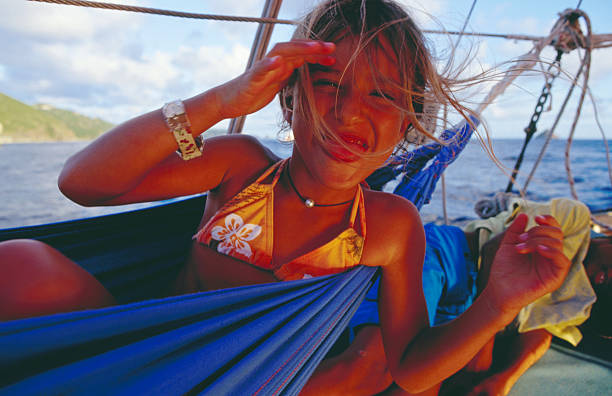 Portrait of young girl in hammock on yacht on  Caribbean Sea off St Barts.