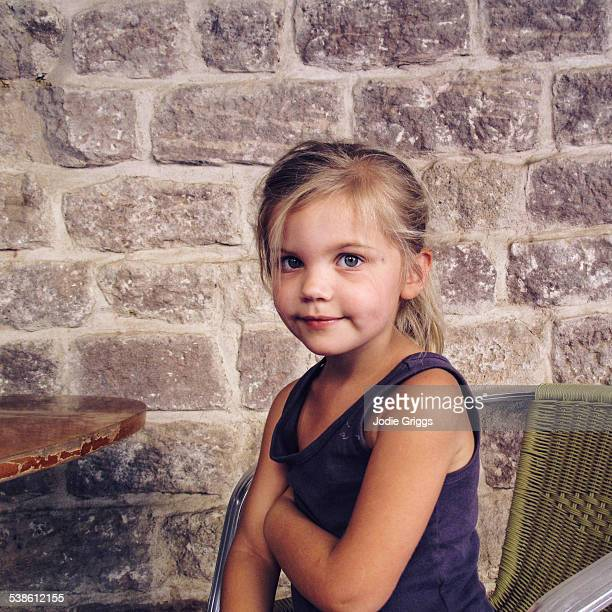 Portrait of young girl looking at camera