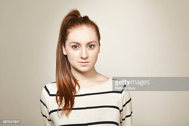 portrait of young girl looking to camera - ponytail stock pictures, royalty-free photos & images
