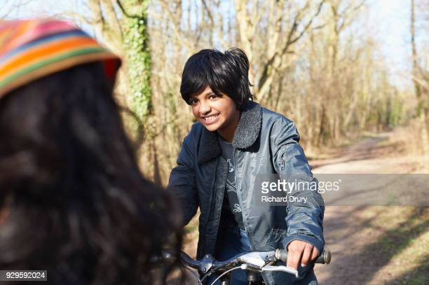 portrait of young girl on cycle track - richard drury stock pictures, royalty-free photos & images