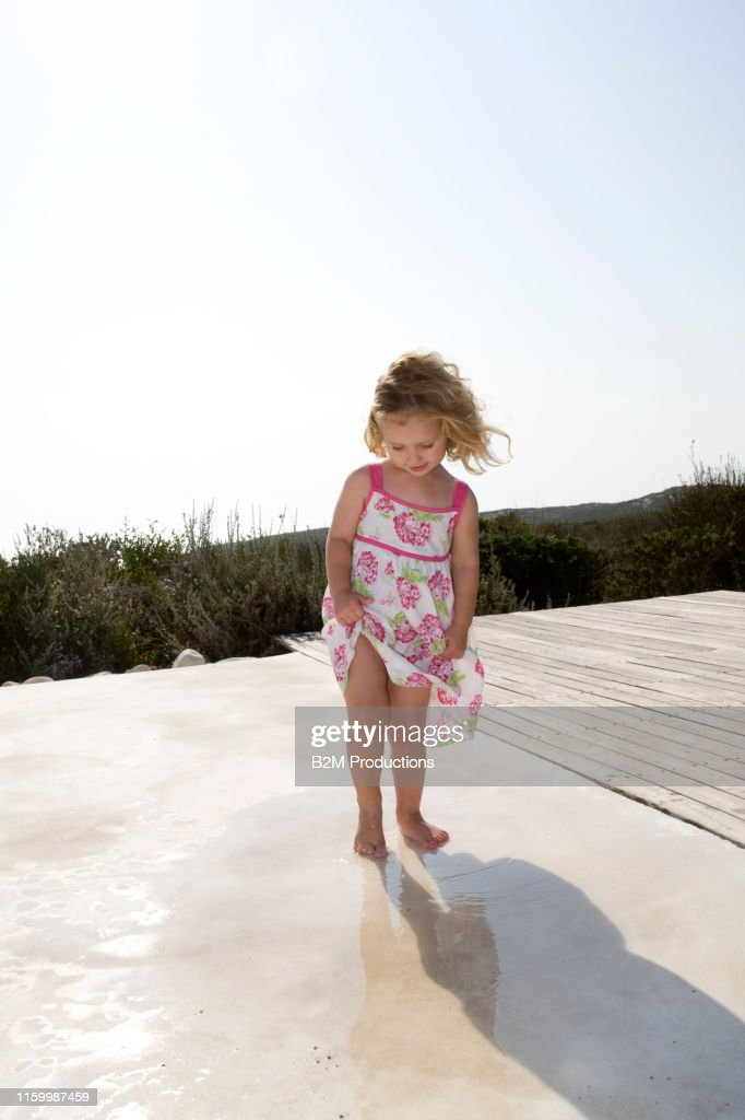 A Portrait Of Young Girl In Fedora High-Res Stock Photo
