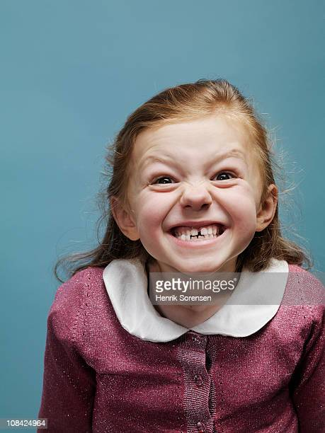 Portrait of young girl pulling a face