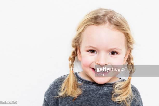 portrait of young girl, smiling, against white background - 4 5 jahre stock-fotos und bilder