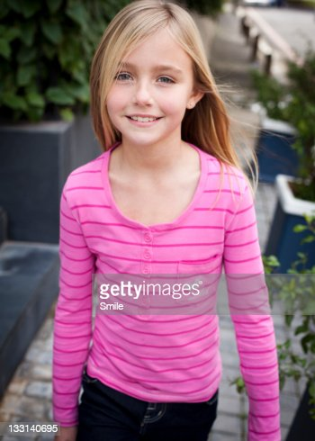 Portrait of young girl smiling stock photo getty images - Teen age girl picthar ...