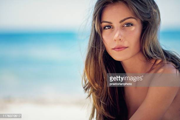 portrait of young girl standing on the beach and enjoying the ocean - sexy hot lady stock pictures, royalty-free photos & images