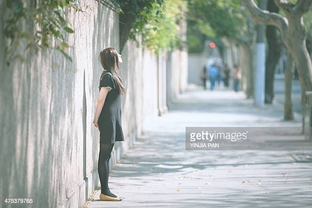 Portrait of young girl standing on the street