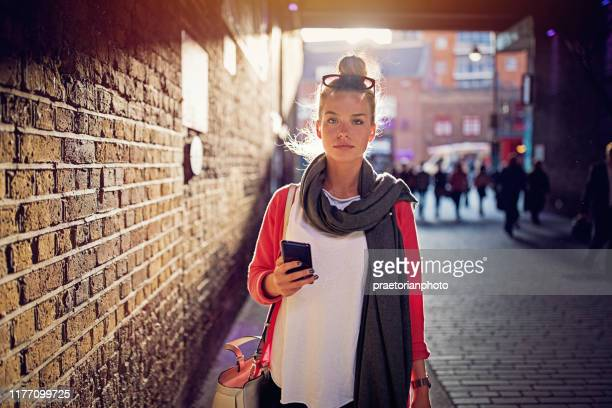 portrait of young girl walking in london city - pedestrian stock pictures, royalty-free photos & images