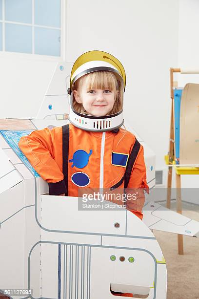 Portrait of young girl, wearing astronaut outfit