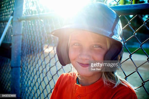Portrait of young girl wearing baseball kit
