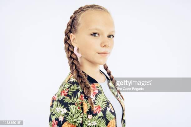 portrait of young girl with braided hair - blaue augen stock-fotos und bilder