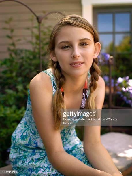 "portrait of young girl with braided hair - ""compassionate eye"" - fotografias e filmes do acervo"