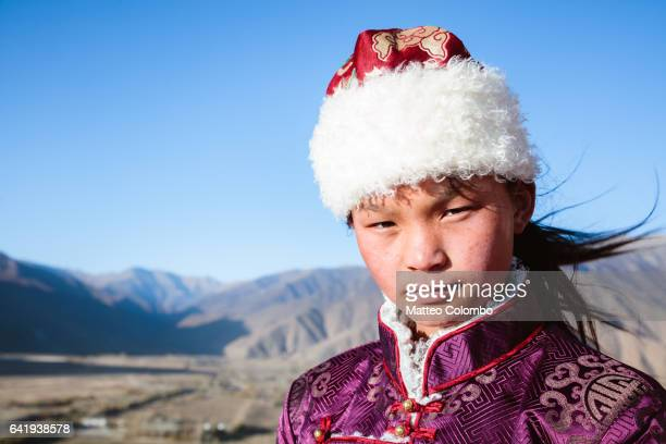 Portrait of young girl with traditional dress, Tibet