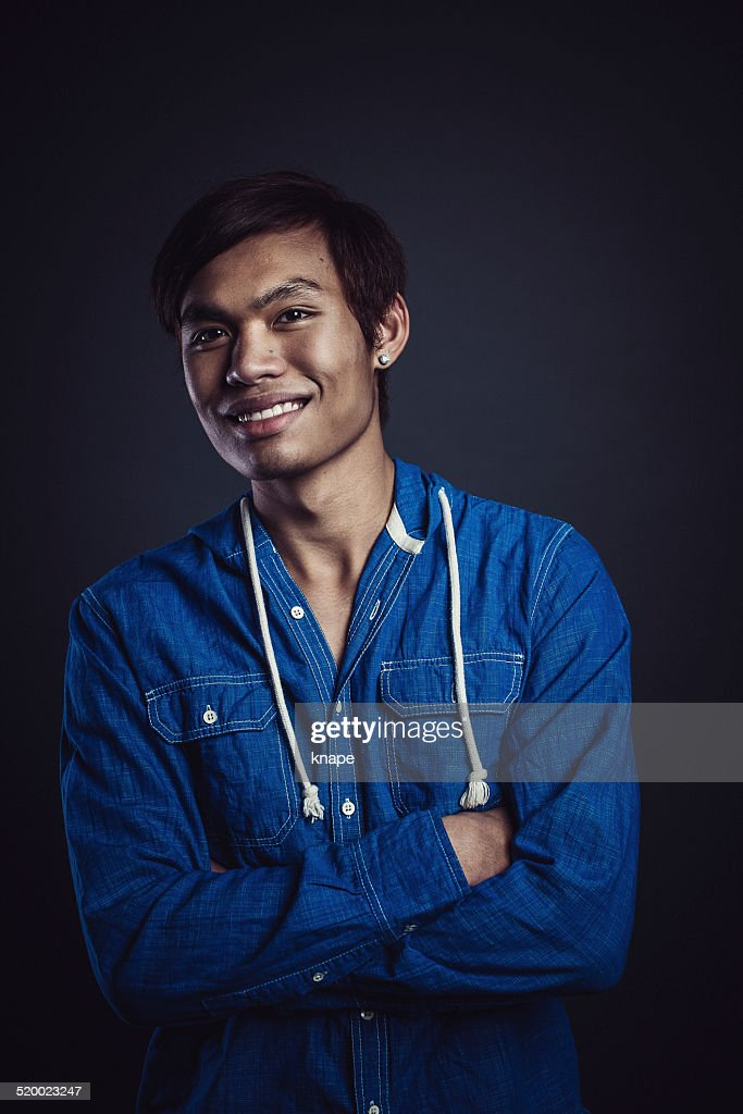 Portrait of young handsome man in studio : Stock Photo