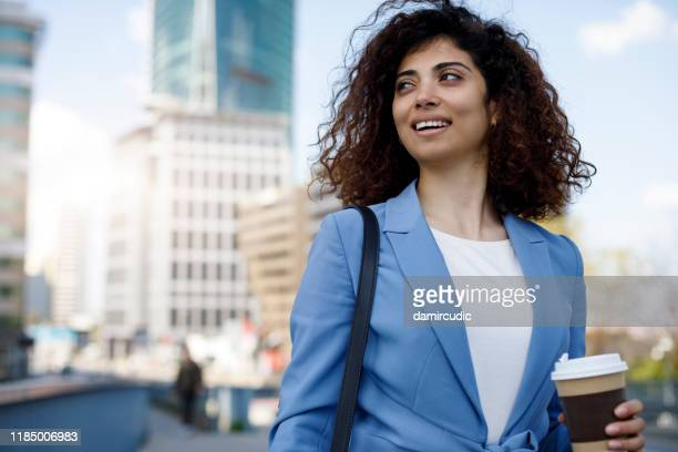 portrait of young happy businesswoman communting to work - damircudic stock photos and pictures