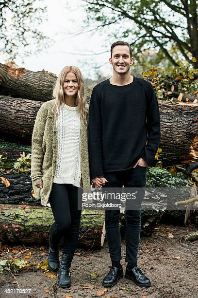 portrait of young happy couple in woods - robin skjoldborg stock pictures, royalty-free photos & images