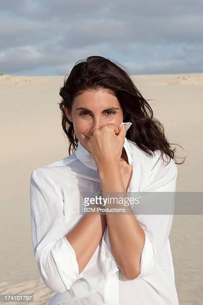 Portrait Of Young Happy Woman In Desert
