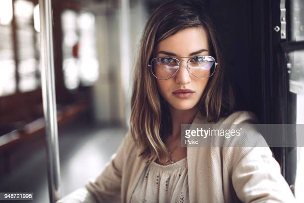 portrait of young hipster woman with eyeglasses - occhiali da vista foto e immagini stock