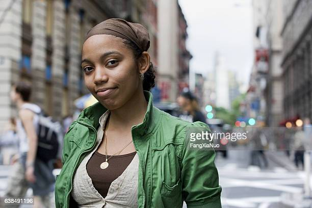 portrait of young hispanic woman in downtown city - new yorker building stock photos and pictures