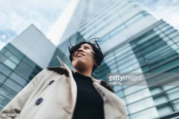 portrait of young japanese businesswoman - low angle view stock pictures, royalty-free photos & images