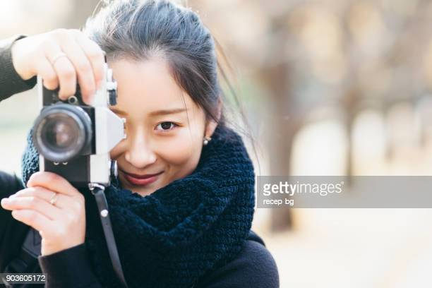 portrait of young japanese female photographer - capturing an image stock pictures, royalty-free photos & images