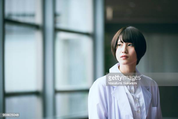 portrait of young japanese female researcher - japanese ethnicity stock pictures, royalty-free photos & images
