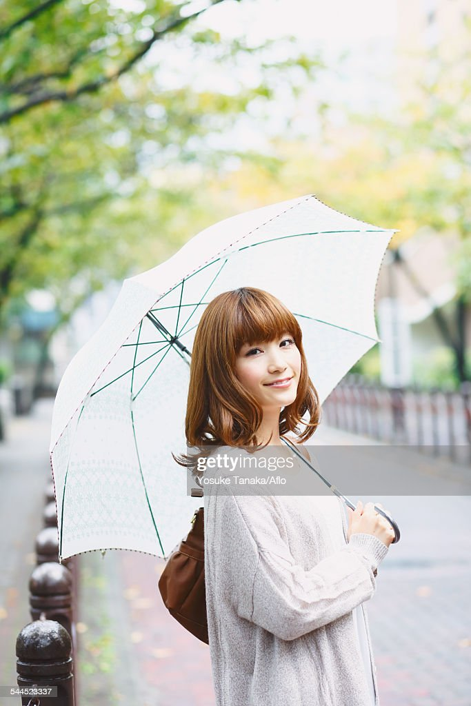 Portrait of young Japanese woman in a park : Stock Photo