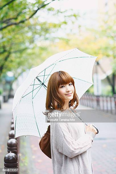 Portrait of young Japanese woman in a park