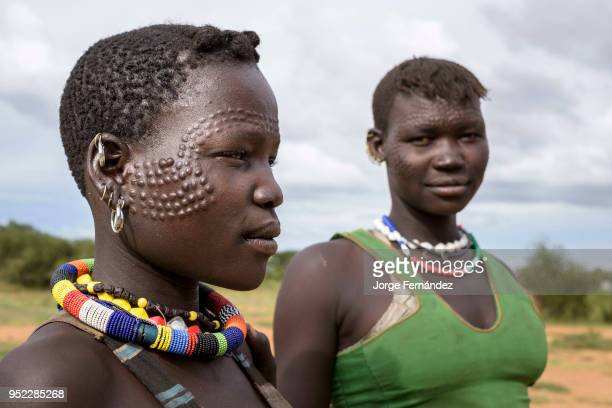 Portrait of young Karamajong women with traditional scars on their faces