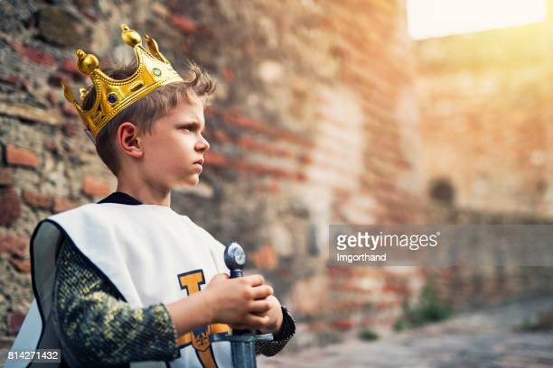 Portrait of young king at the castle walls