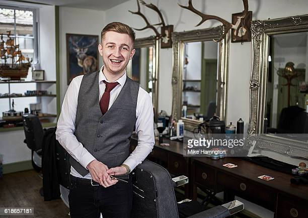 Portrait of young male barber