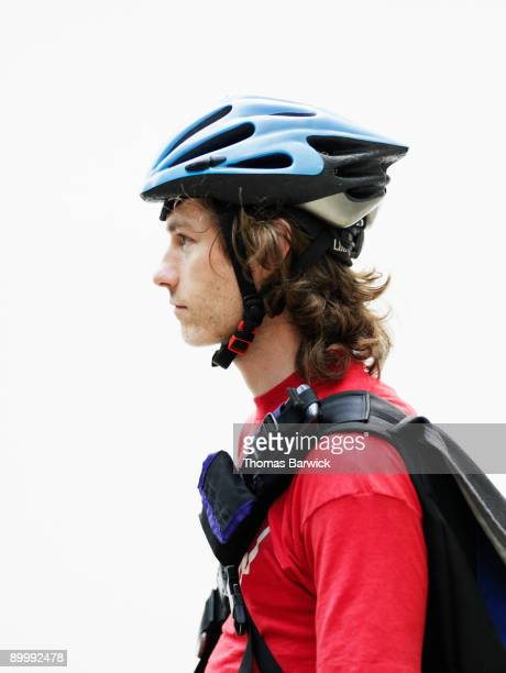 portrait of young male bicycle messenger - サイクリングヘルメット ストックフォトと画像
