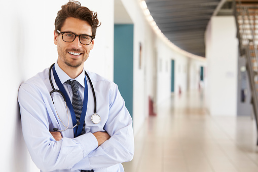 Portrait of young male doctor with stethoscope, close up 862722044