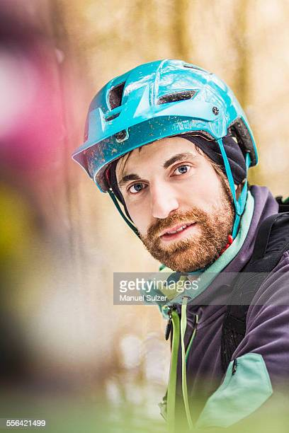 Portrait of young male mountain biker in forest