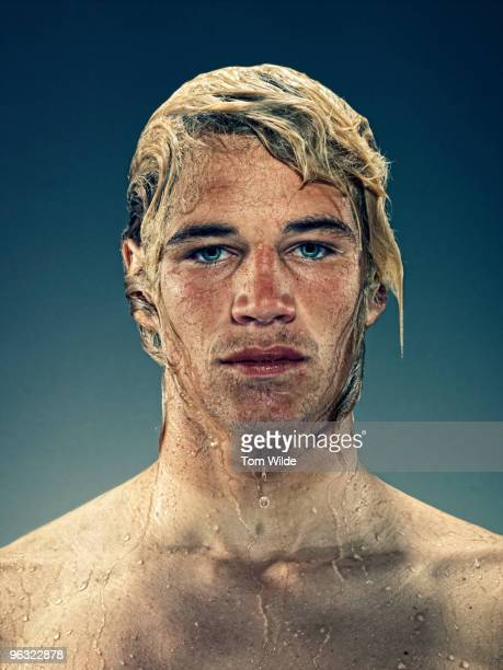 Portrait of young male surfer with wet hair