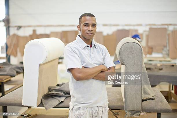 Portrait of young male upholsterer in workshop