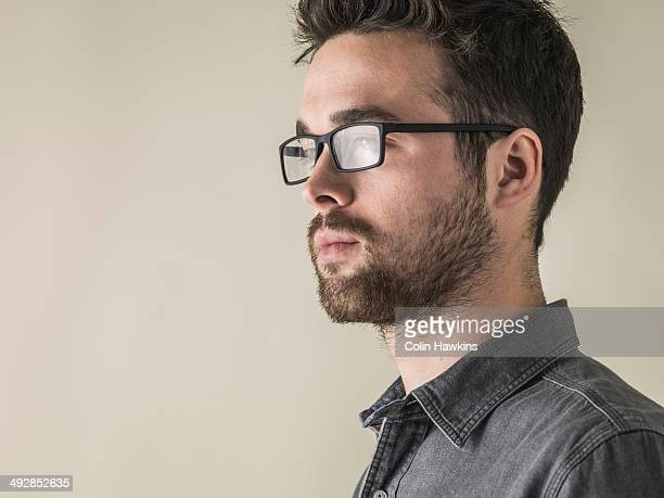 Portrait of young male wearing glasses