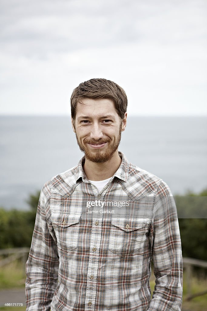 Portrait of young male with a positive expression : Stock Photo
