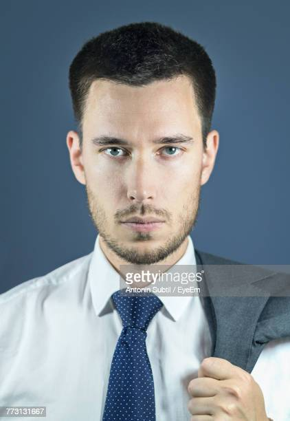 Portrait Of Young Man Against Colored Background