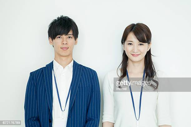 portrait of young man and businesswoman - 20代 ストックフォトと画像