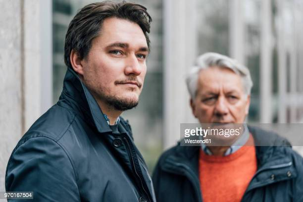 portrait of young man and senior man in the city - successor stock pictures, royalty-free photos & images