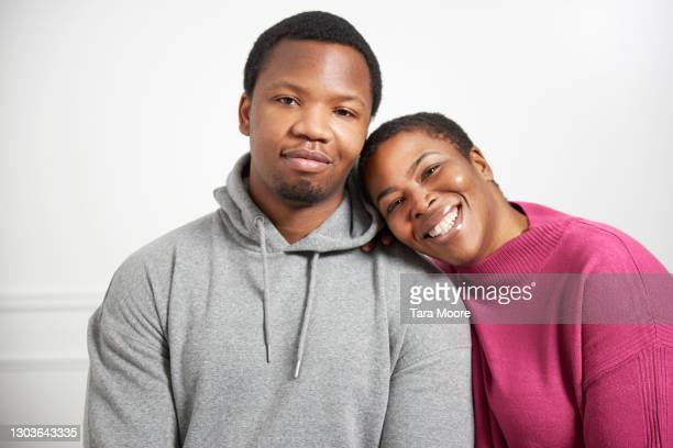 portrait of young man and woman - human joint stock pictures, royalty-free photos & images